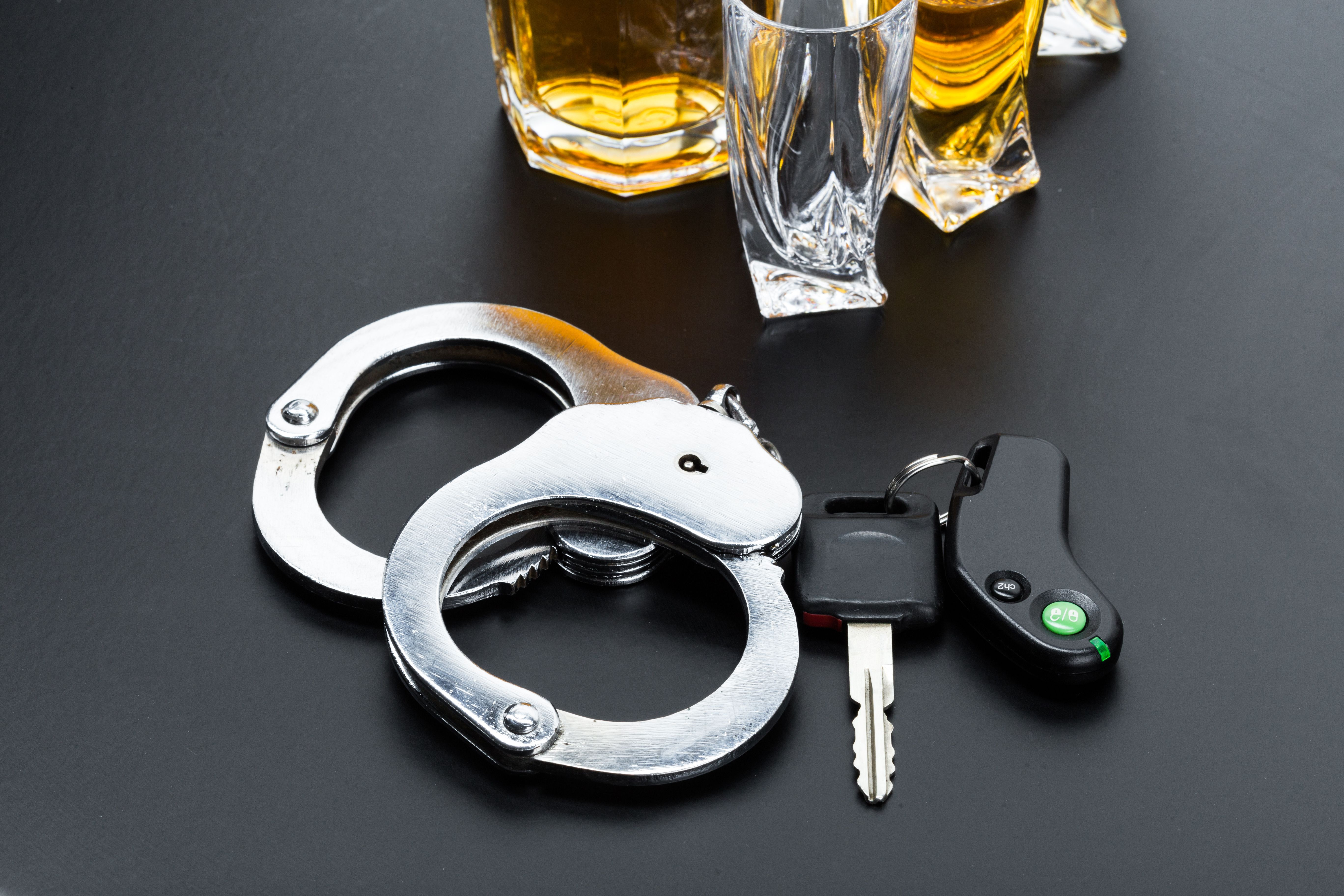 Handcuffs, car keys and alcohol - Sarasota DUI lawyer